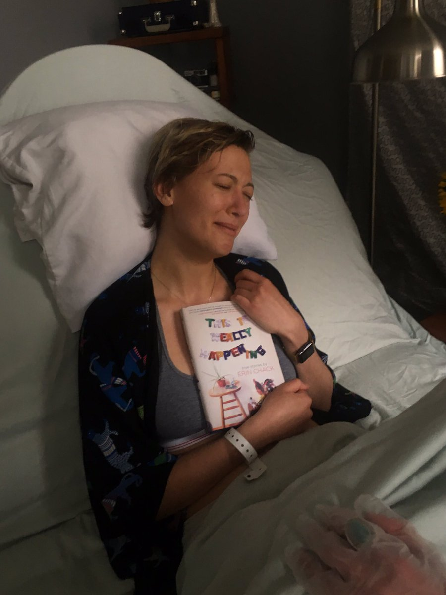 Author celebrates the 'birth' of her new book with hilariously literal photo shoot.