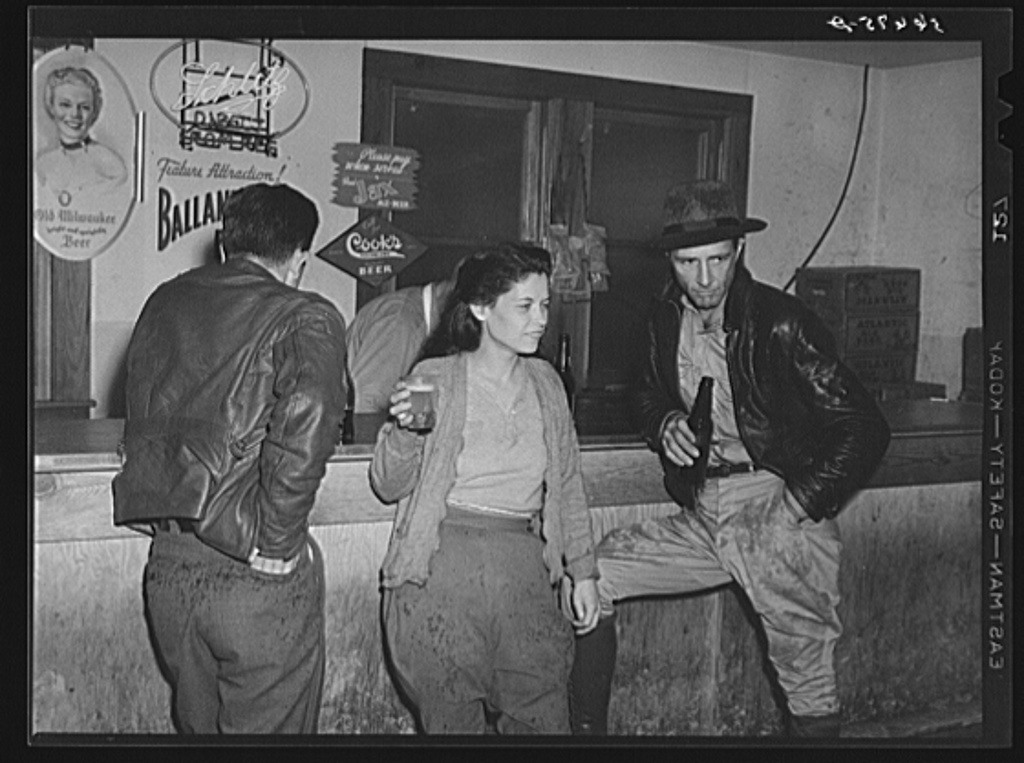 """Construction workers drinking beer in Soldier's Joy Cafe near Camp Blanding, Starke, Florida."" 1940."