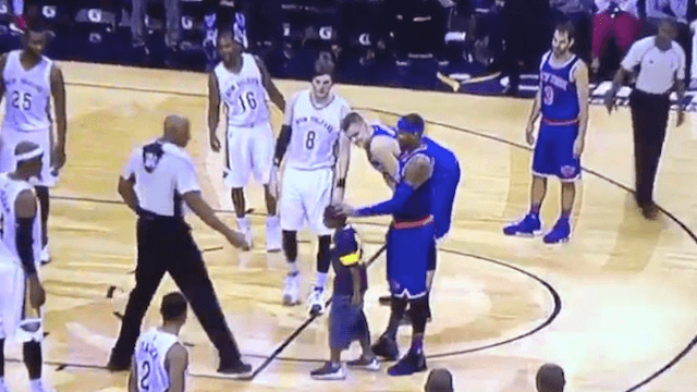 Little boy runs on the court mid-game to give Carmelo Anthony a much-needed hug.