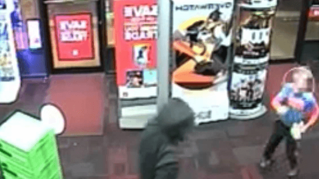 Extremely brave 7-year-old boy punches a robber at a GameStop.