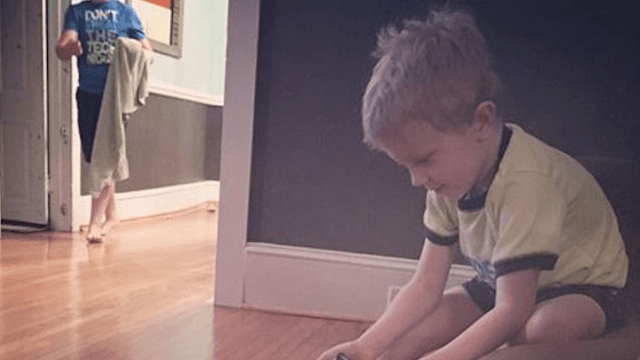Little boy finds adorably ineffective way to train his puppy.