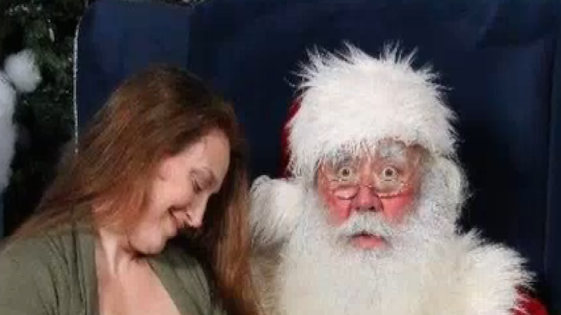 A mom took a breastfeeding pic with Santa, and people are debating whether it's naughty or nice.