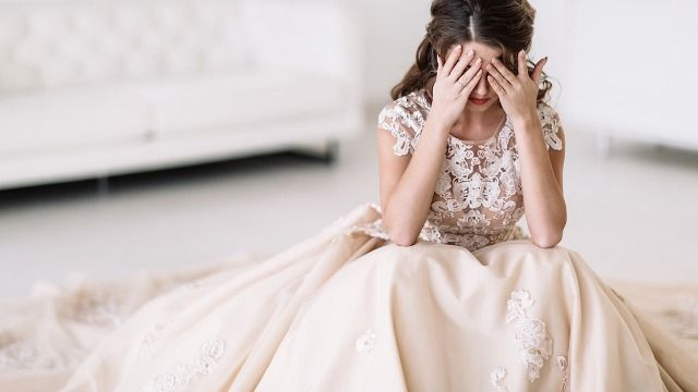 Bride asks if she'd be wrong to elope after parents cut wedding budget down to $20k.