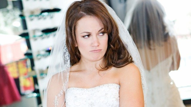 Bride criticized after asking if it's okay to make her bridesmaid get a certain haircut.
