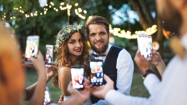 Bride asks if it's wrong to delete photos of friend getting engaged at her wedding.