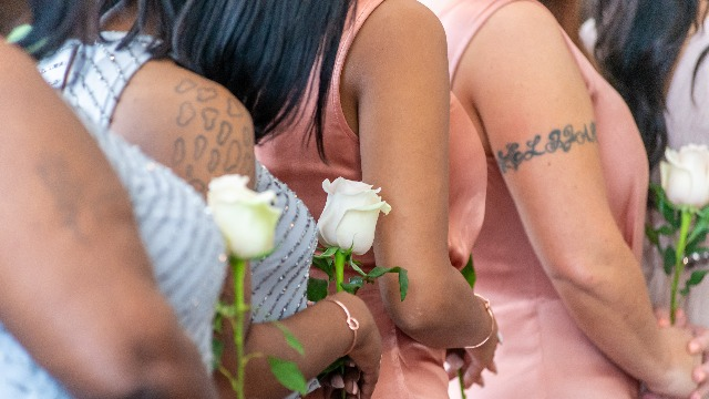Bride asks if she was wrong to photoshop her sister's NSFW tattoo out of her wedding pictures.