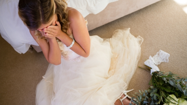 Wedding planner shares story of bride in complicated dress having 'digestive issues' at reception.