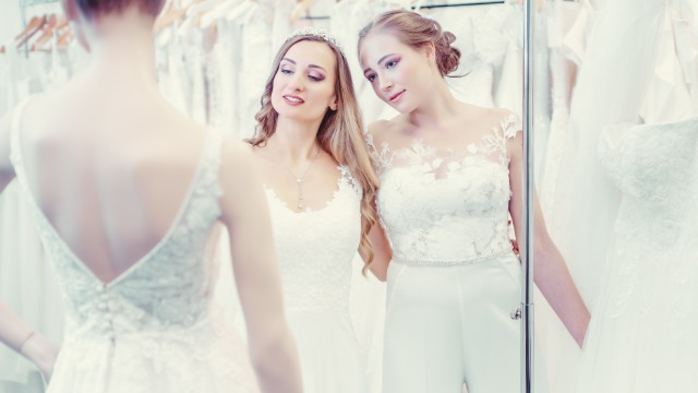 Bride asks if it's okay to make 'tomboy' maid of honor wear a dress.