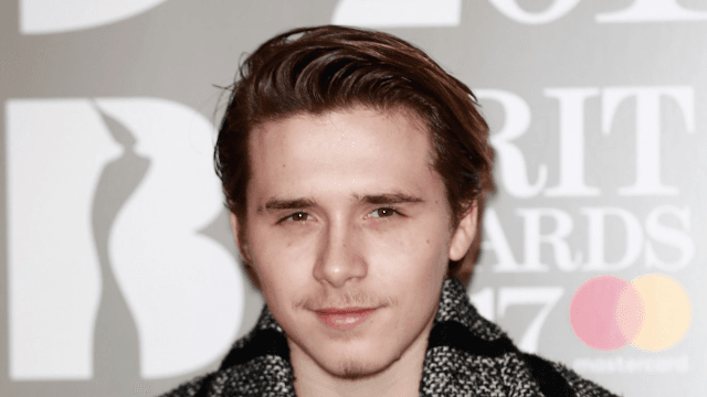 Brooklyn Beckham shaved his head and looks even more like his dad now.