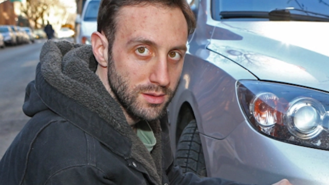 Fed-up man gets revenge by putting cruelly honest bumper stickers on illegally parked cars.