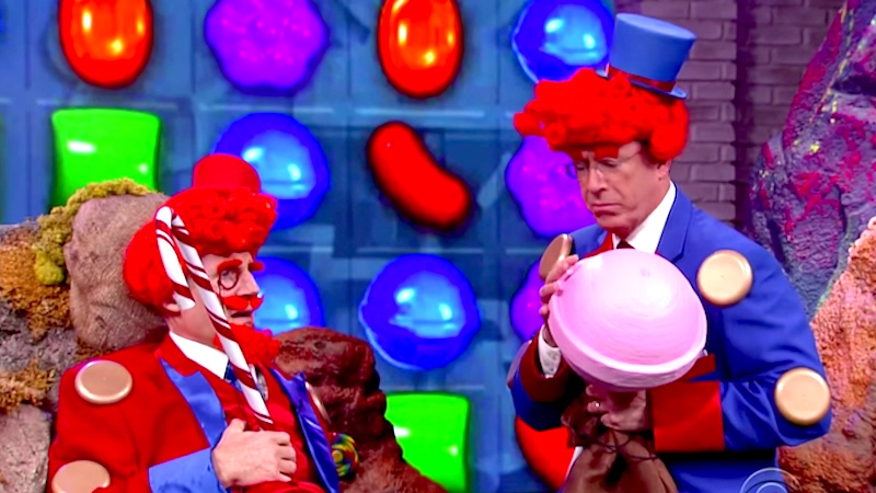 Stephen Colbert and Liam Neeson's particular set of skills star in 'Candy Crush: The Movie.'