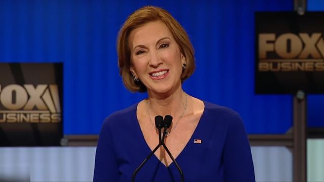 Carly Fiorina won the news coverage of the undercard #GOPDebate with her Hillary Clinton diss.