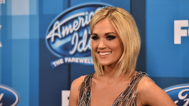 Carrie Underwood clapped back at someone who criticized her new NFL song — and now she's being accused of cyber-bullying.