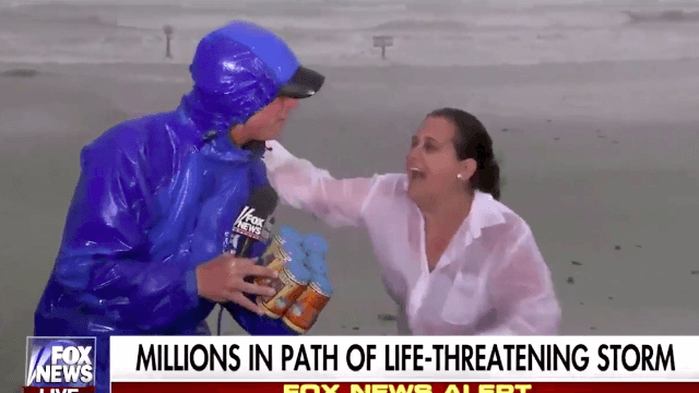 Woman braves Texas hurricane to bring reporter a six pack of beer.