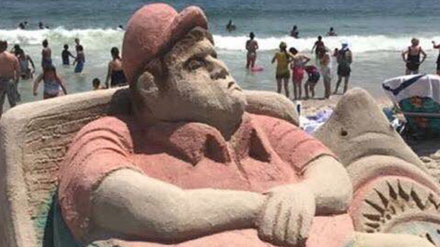 A perfect Chris Christie sculpture rose from the sand as soon as he reopened the beaches.
