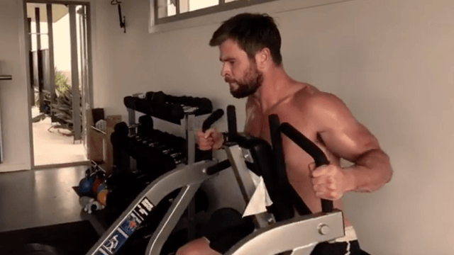 Chris Hemsworth shows off his Thor muscles in intense workout video.