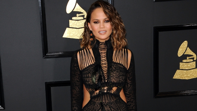 Chrissy Teigen gets into funny back and forth with woman who said John Legend looked like 'a fool' at the Grammys.