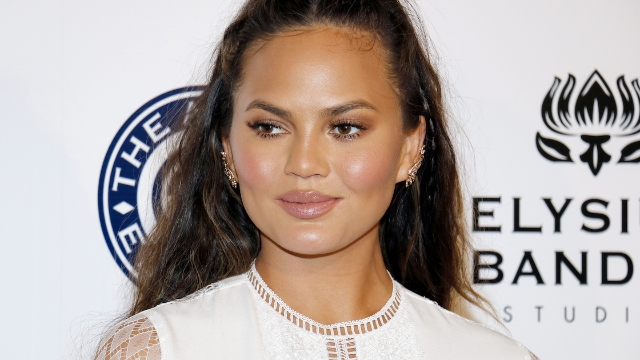 Chrissy Teigen responds to commenter accusing her of photoshopping Instagram pool photo.