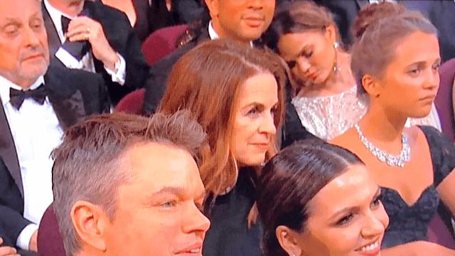 Sleeping Chrissy Teigen unintentionally photobombed every celebrity during the Oscars.