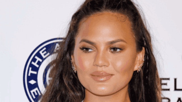 Chrissy Teigen's breast made a surprise appearance at John Legend's show.