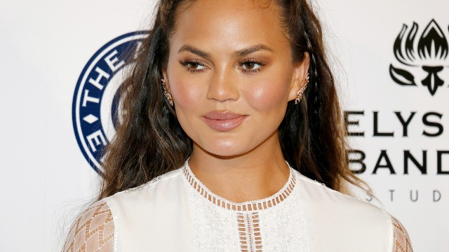 Chrissy Teigen gets criticized for joking about buying $1000 bags at Barneys in order to use the bathroom.