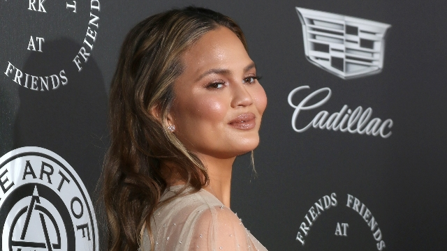 Chrissy Teigen responds to guy on Instagram who accused her of Photoshopping her butt.