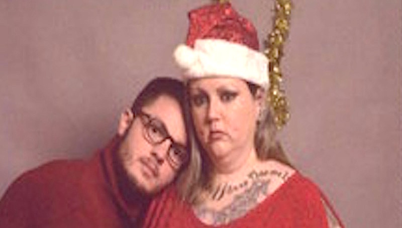 Student pranks his family back home by posing with a fake family for his Christmas card.
