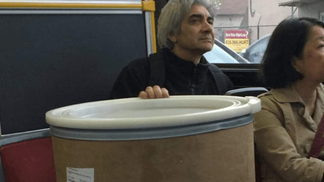 Where is this man who casually brought a giant vat of frosting on the bus going, and can I come?