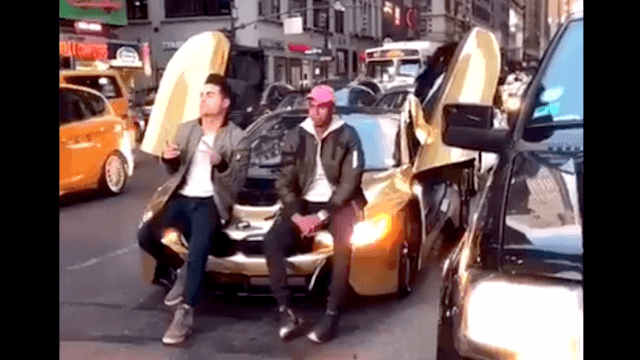 YouTuber blocking NYC traffic to pose with his sports car learns why that's a bad idea.