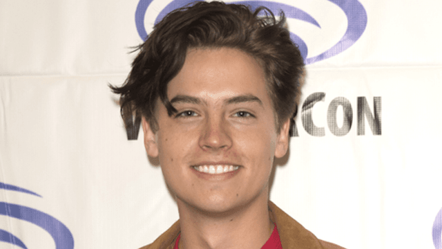 Cole Sprouse jokes that he conned his way into kissing Lili Reinhart on 'Riverdale.'