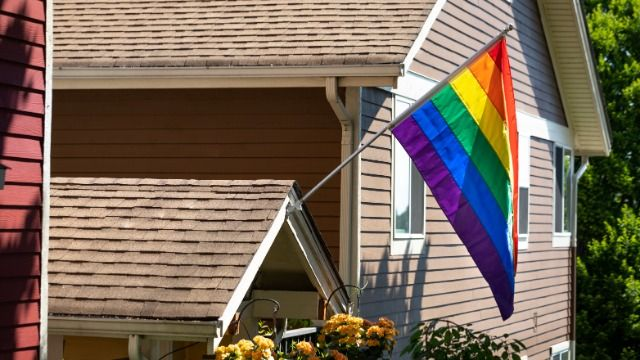 Family lights up house in Pride colors after their HOA banned rainbow flags.