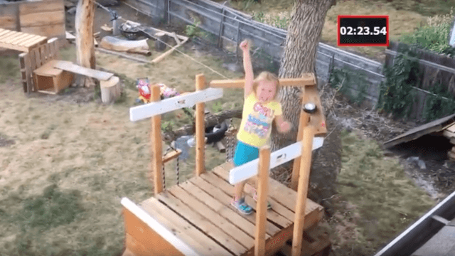 Dad builds insane backyard obstacle course for his tiny Ninja Warrior daughter.