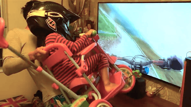 Awesome dad gives his daughter an in-home mountain bike ride that looks better than VR.