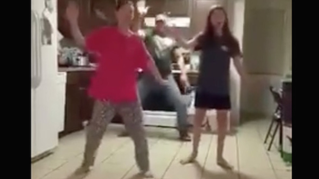 The best thing about this dad videobombing his daughters is how much better at dancing he is.