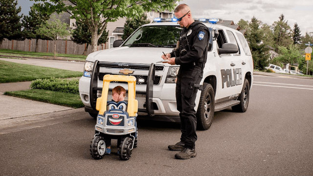 Photographer mom captures her 2-year-old dealing with adult situations in his Little Tikes car.