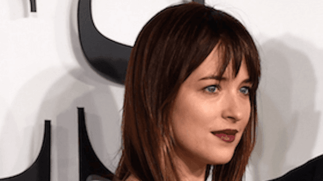 Dakota Johnson's new tattoo is 'a lil f**ked up.' But she's okay with it.