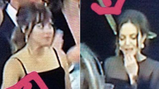 Everyone's watching Dakota Johnson watch Angelina Jolie ignore Jennifer Aniston at the Golden Globes.