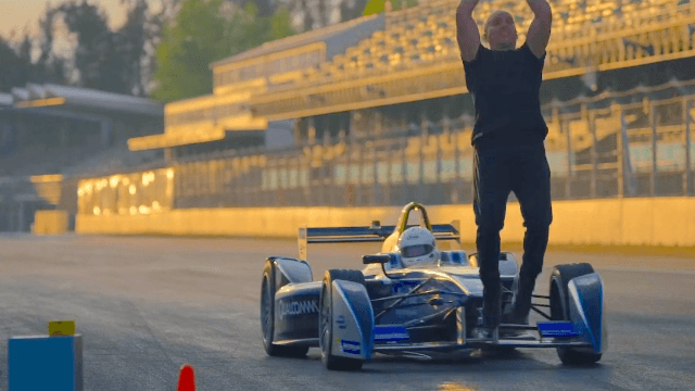 Your stomach will jump as this stuntman does a backflip over a Formula E car going 60+ mph.