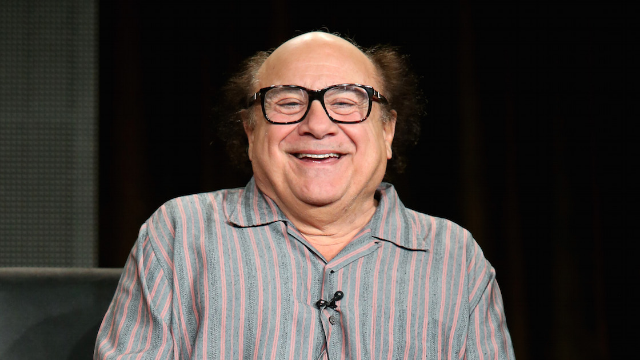 Returning favor, Danny DeVito poses with cutout of Carlisle student