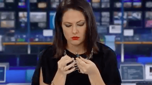 Daydreaming news anchor realizes she's on camera, panics so hard she nearly loses her jaw.