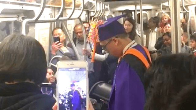 Subway riders saved the day when student on stranded train missed his graduation.