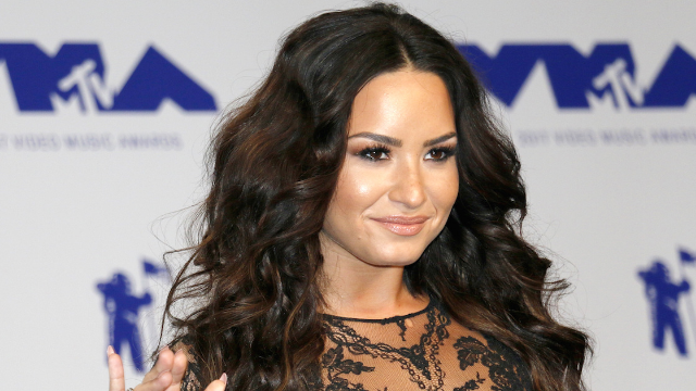 Demi Lovato teases fans with picture of new blonde hair. She's cool for the summer.