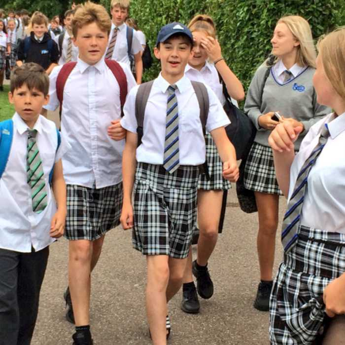 52356dafc93 Teenage boys wear skirts to school to protest the no shorts dress code.