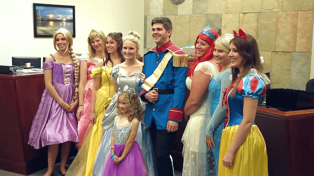 Little girl's adoption hearing becomes real-life fairy tale when Disney princesses arrive.