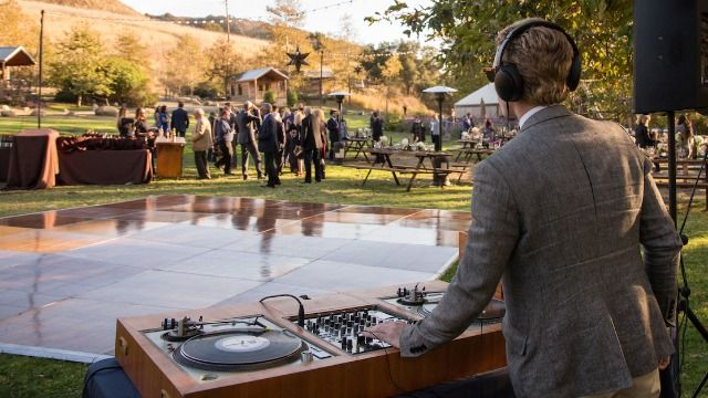 DJ asks if he was wrong to promote his business during a wedding.