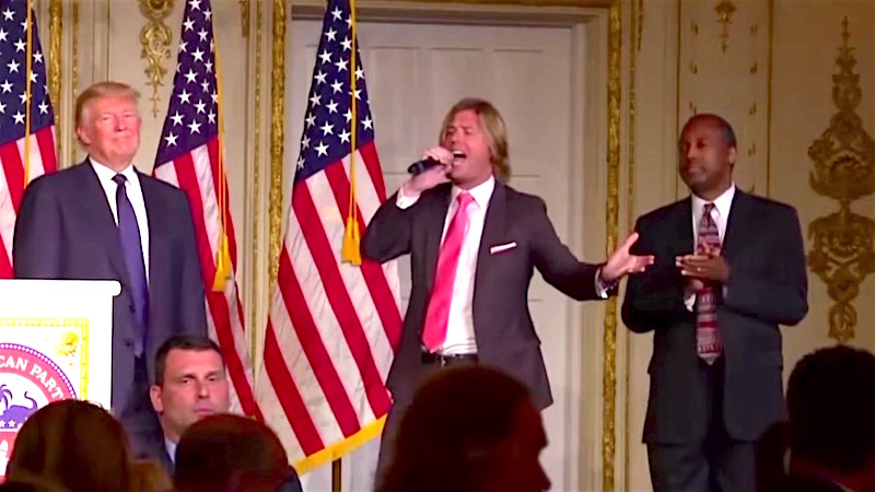 Donald Trump and Ben Carson awkwardly swayed together as a Fabio lookalike sang 'Donald, Donald, stand by me.'