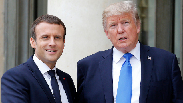 Trump just humiliated the French president by calling out his 'dandruff.'