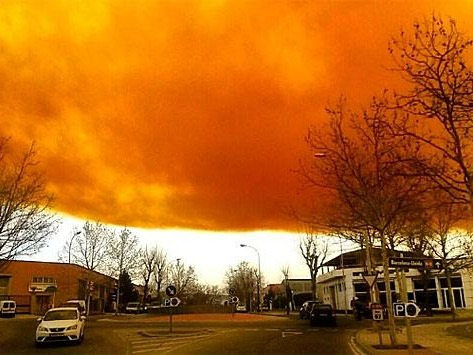Don't mind the toxic orange cloud hovering near Barcelona today.
