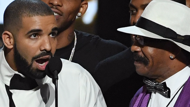 SOS: Drake's dad just got a massive, sexy tattoo of his son's face. Get the champagne.