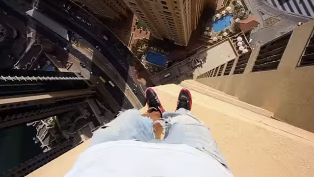 Live and almost die vicariously through this POV video of a teen hopping on the ledges of a Dubai skyscraper.